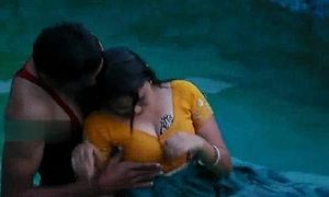 Lovers sexy romance in swimming pool