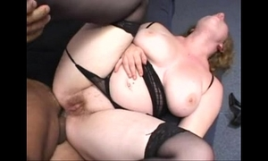 Chubby redhead screwed in the butt wearing a strap