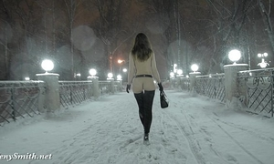 Jeny smith bare in snow fall walking throughout the town