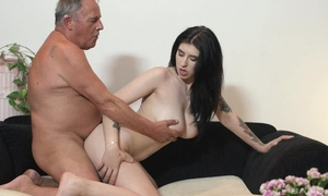 Dark-haired minx with tattoos fucks old man on the couch